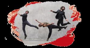 Une ligne de danseurs en mouvement. Certains sautent en l'air. Le danseur le plus à droit porte un nez de clown